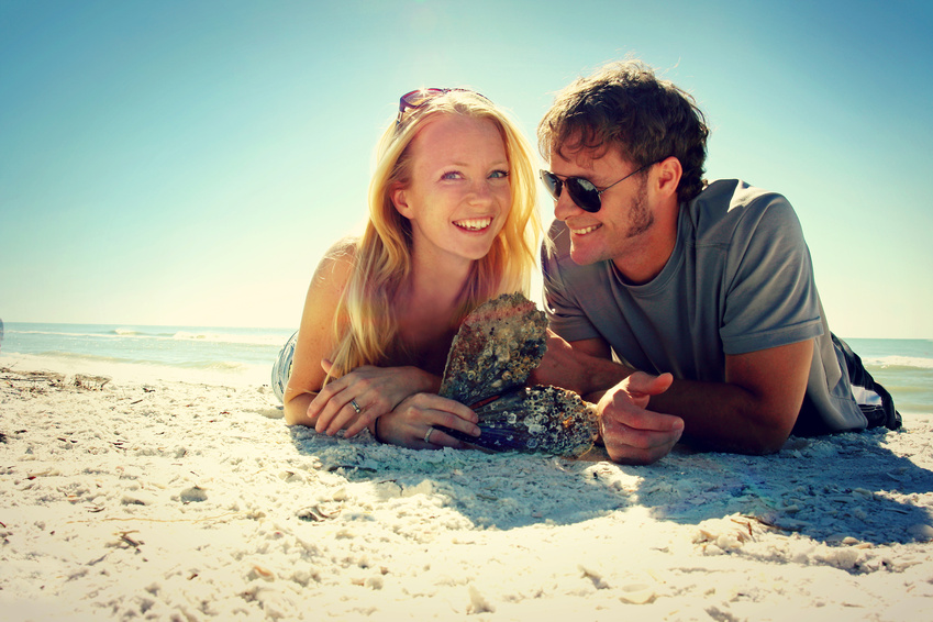 Smiling Couple at Beach in the sun, which increases vitamin D production and fertility