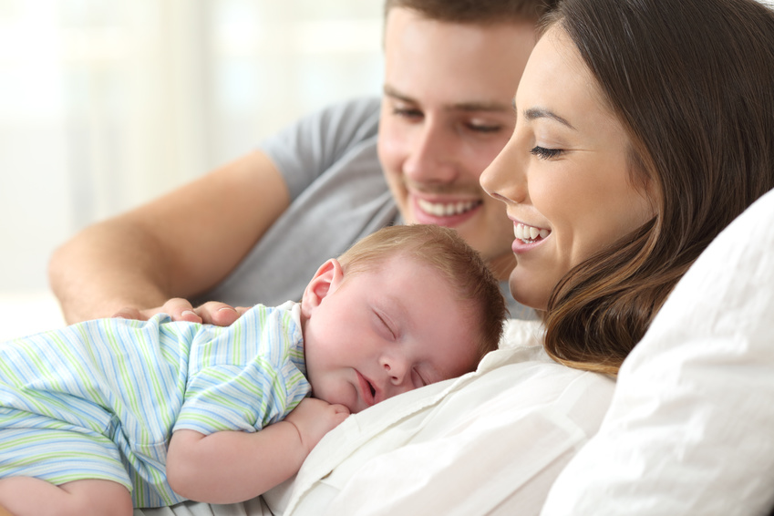 happy couple with baby